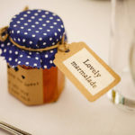 Wedding favour jar of marmalade with tag and sticker