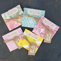 Colourful seed packet wedding favours