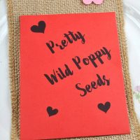 Red wedding favour seed packet with poppy seeds
